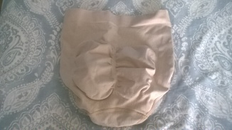 Rear view of the granny panties. The two oval shapes are where the material is is less elasticated. This gives your bum a fuller, more feminine shape.