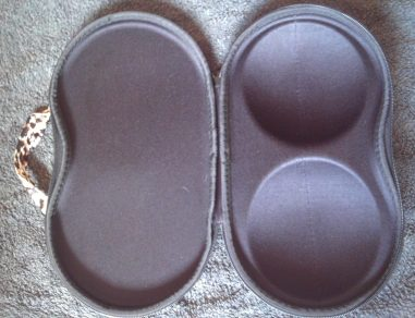 Fully opened case showing interior view. The hardened shells for the bra cups are clearly visible.